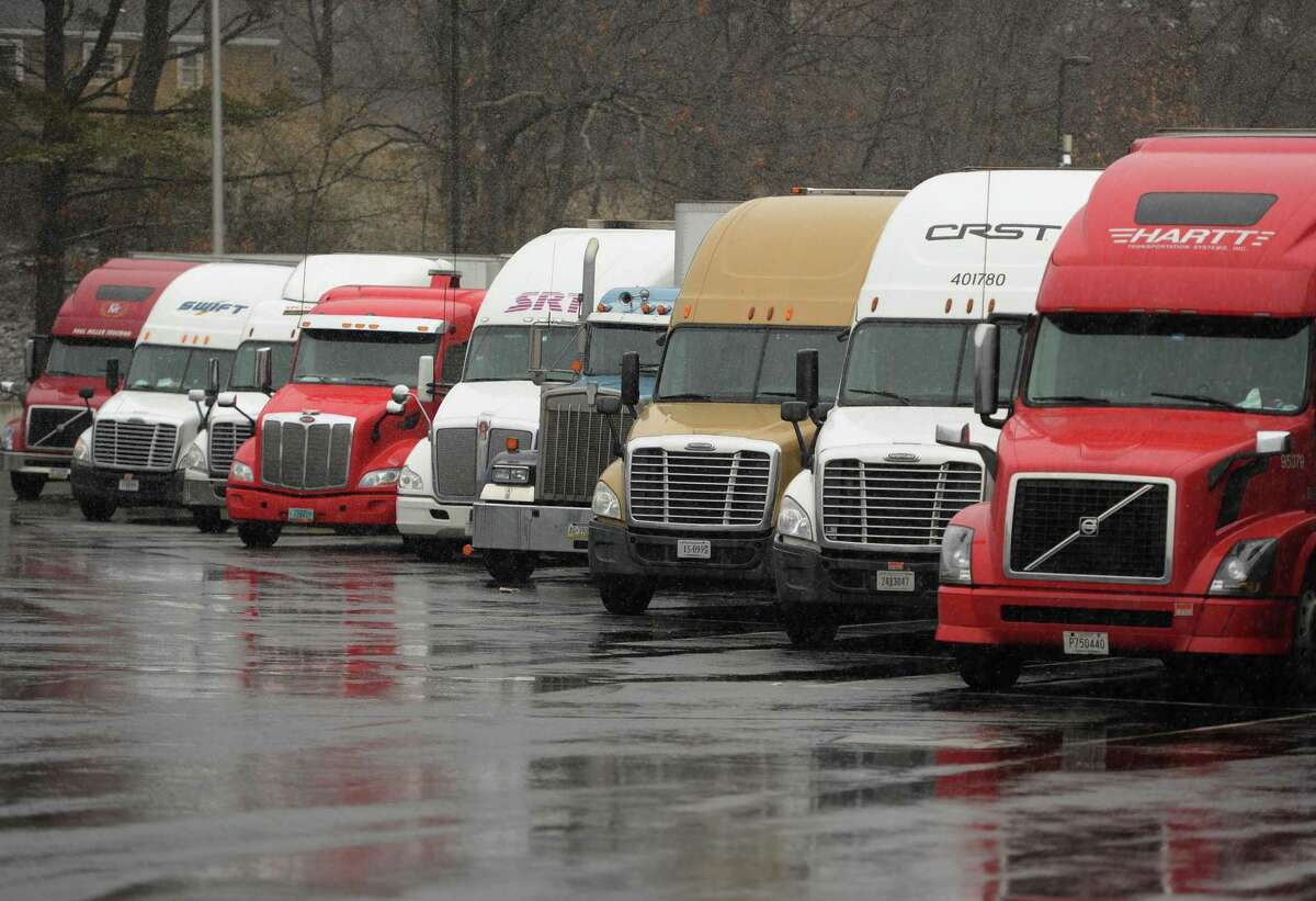 Trucks pack the highway rest area on I-95 south in Fairfield, Conn. with a tractor trailer ban in effect on New York State highways during the snow on Wednesday, March 21, 2018.