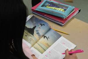 A student works on a reading assignment in an ESL class at New Milford High School in 2020. Statewide data show that English language learners were more likely to be chronically absent than their English-speaking peers during much of the pandemic.