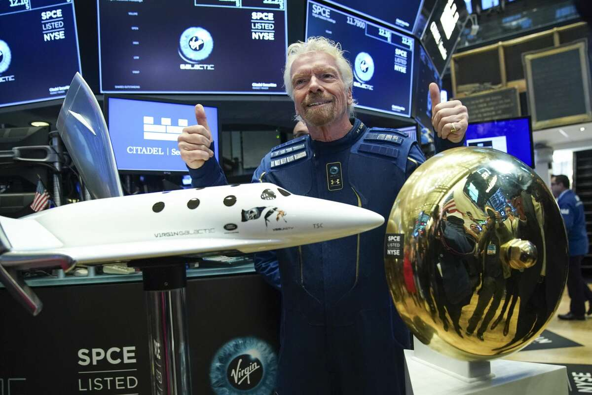 NEW YORK, NY - OCTOBER 28: Sir Richard Branson, Founder of Virgin Galactic, poses for photographs before ringing a ceremonial bell on the floor of the New York Stock Exchange (NYSE) to promote the first day of trading of Virgin Galactic Holdings shares on October 28, 2019 in New York City. (Photo by Drew Angerer/Getty Images)