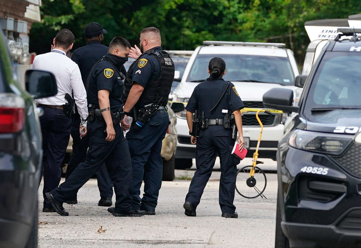 Houston Police and other personnel are shown at the scene of a homicide in the 7000 block of Bellfort Avenue at the Bellfort Plaza Apartments on Tuesday, June 9, 2021 in Houston.