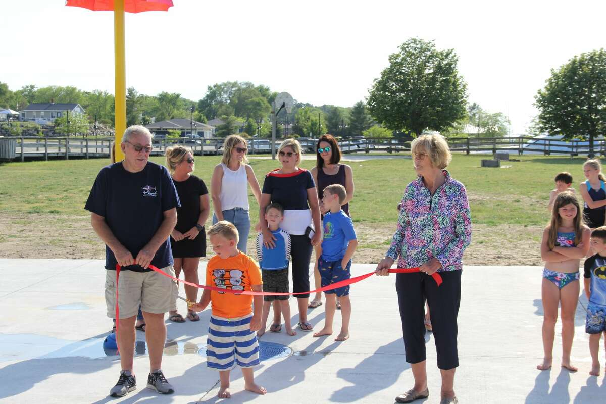 Port Austin residents spent Friday evening in the sun as the new splash pad opened for use. The pad at Bird Creek Park has been in the works five years as is dedicated to the memory of Shari Babcock Etzel.
