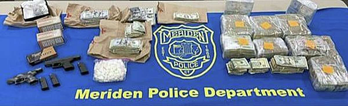 Items seized during a search of a Meriden, Conn., residence on Monday, June 7, 2021.