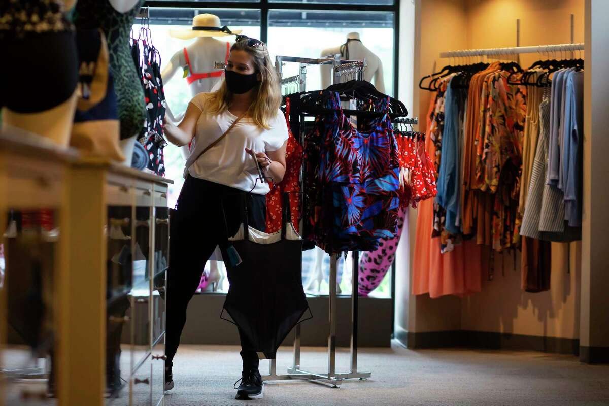 Caroline Jacobs browses swimsuits during her lunch break at Top Drawer Lingerie, a store in Uptown Park, on Thursday, June 3, 2021.
