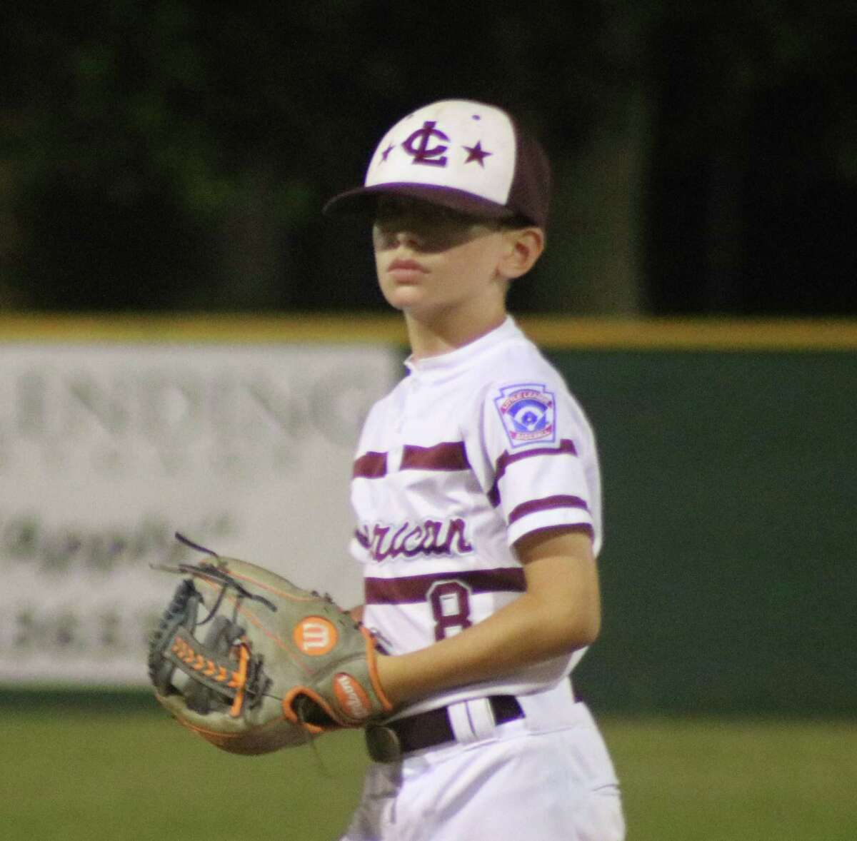 League City Little League 9U American All-Star Caleb Maldonado prepares to throw another pitch during the team's easy win over Texas City Tuesday night.