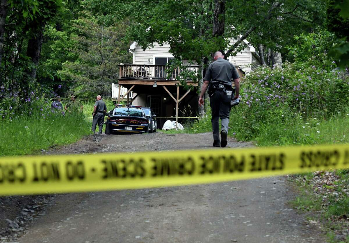 State police investigate the scene of a homicide at a Jay Herrington Road residence on Wednesday, June 9, 2021, in Pittstown, N.Y. (Will Waldron/Times Union)