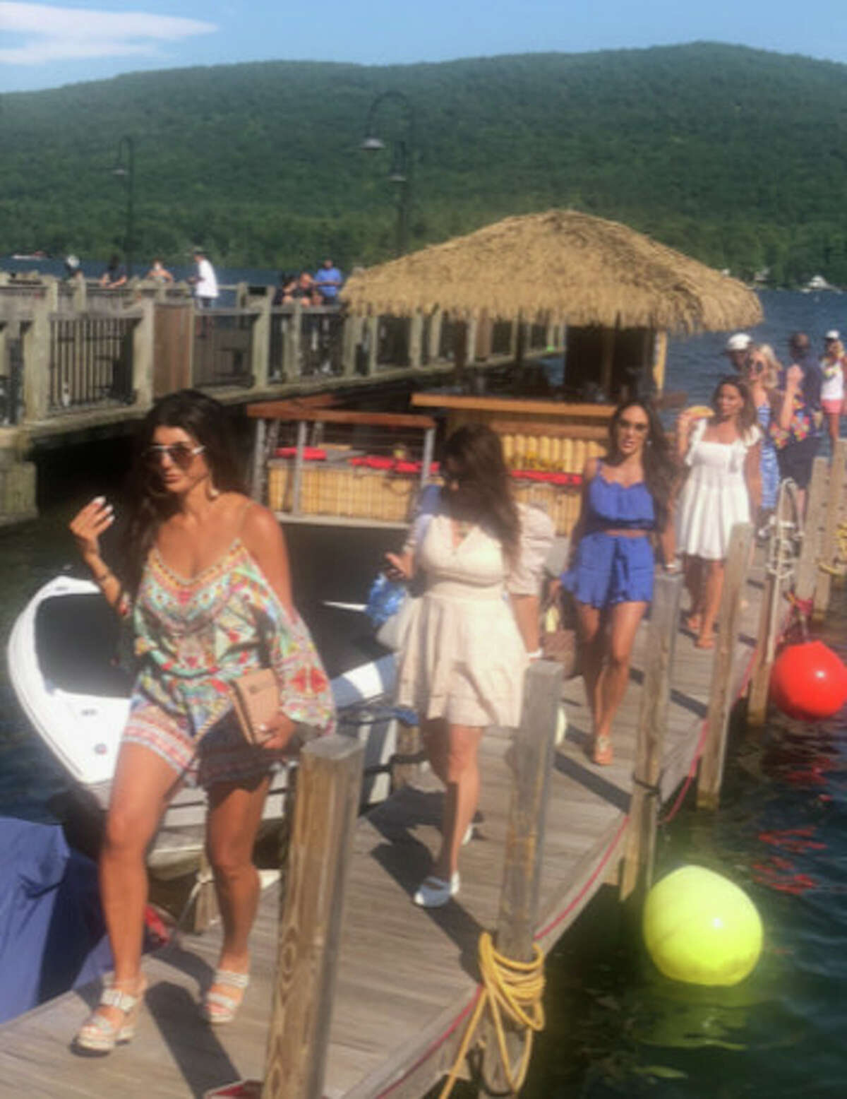 """Cast members of """"The Real Housewives of New Jersey"""" reality series disembark after a cruise on Lake George last summer with The Tiki Tours. (Nancy Hart/The Tiki Tours.)"""