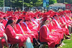 Graduating seniors wait for their turn to walk at their commencement ceremony. (Colin Merry/Record Patriot)