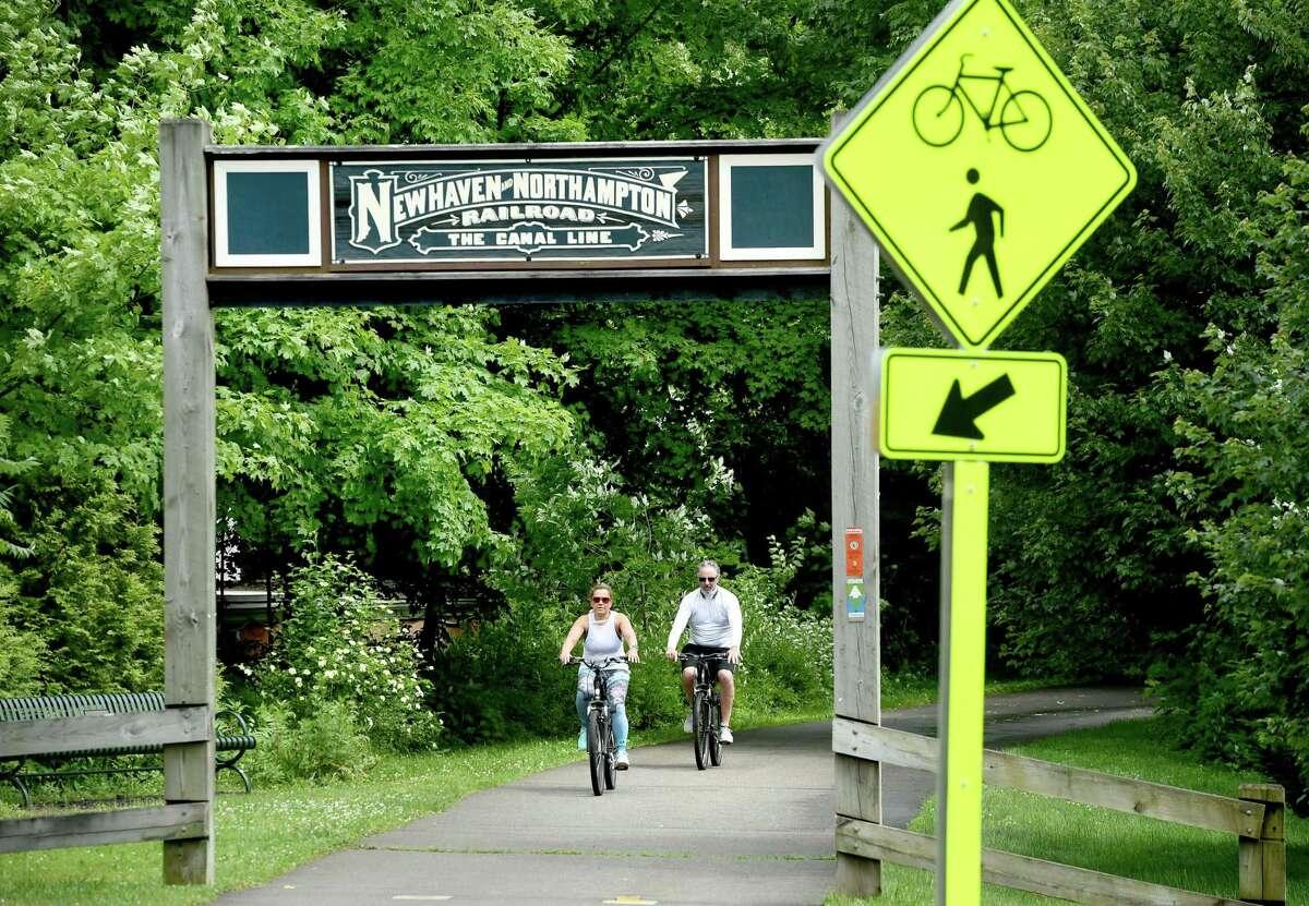 Grace Murcia (left) and her boyfriend, Anthony Fiengo, Jr., of New Haven bike the Farmington Canal Heritage Trail in Hamden on June 21, 2019.
