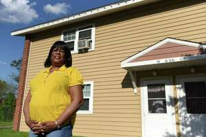 Gloria McKenzie stands outside her apartment at the Ezra Prentice Homes on Monday, May 17, 2021, in Albany, N.Y. (Will Waldron/Times Union)