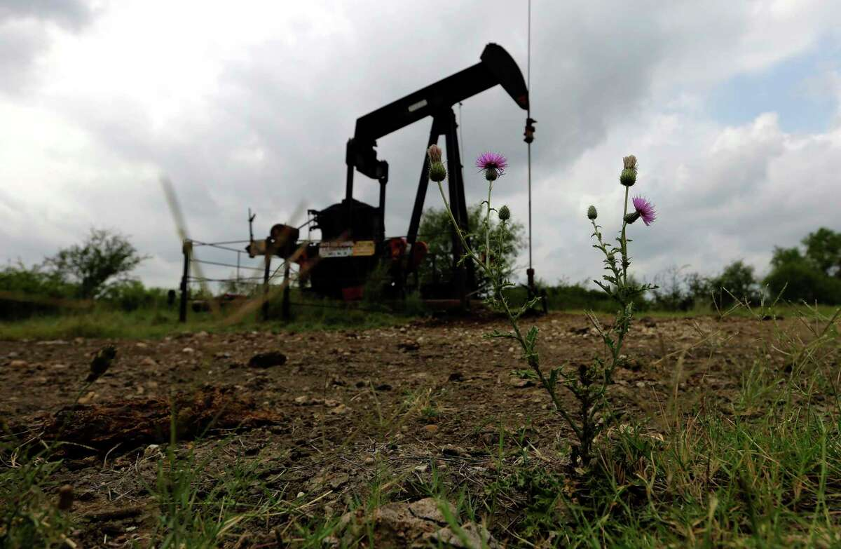 In this Friday, May 13, 2016, photo, a pump jack sits idle on a South Texas ranch near Bigfoot, Texas.