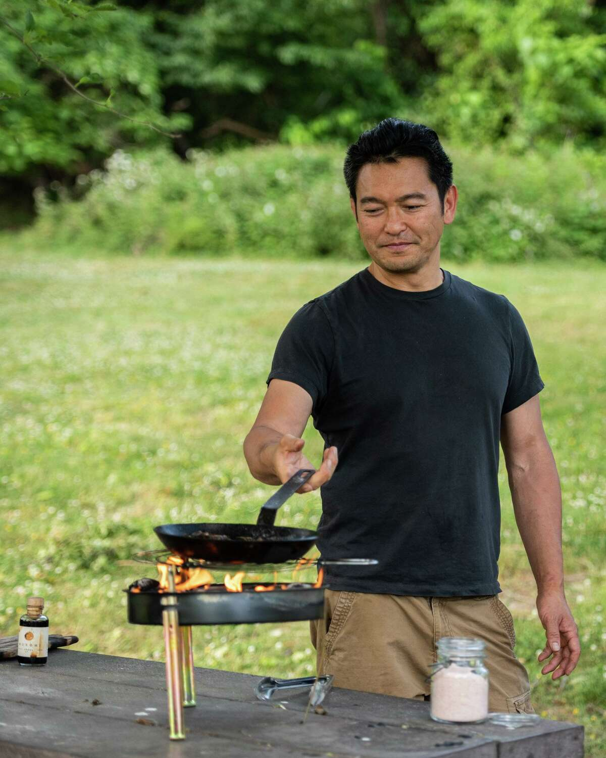 Bun Lai cooks cicadas at a pop-up event in Washington D.C. in May.
