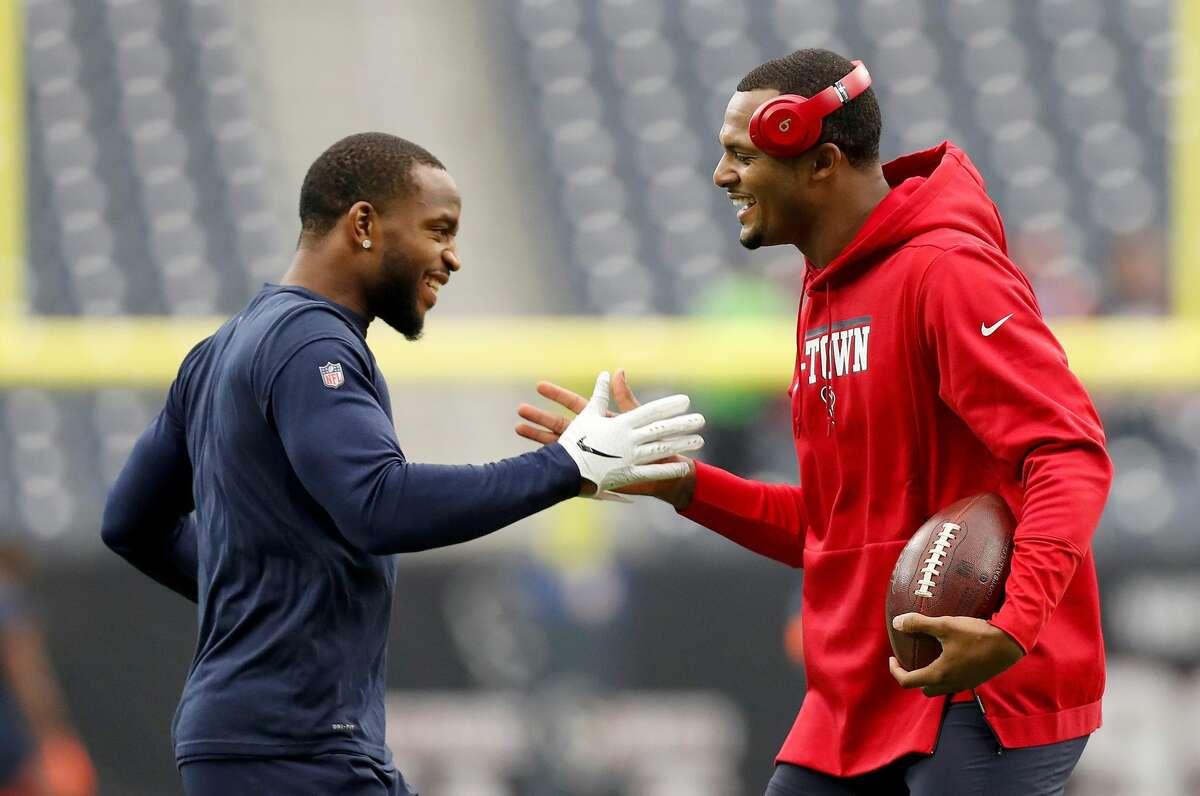 Denver's Kareem Jackson and Houston's Deshaun Watson catch up before the Broncos-Texans game on Dec. 8, 2019 at NRG Stadium.