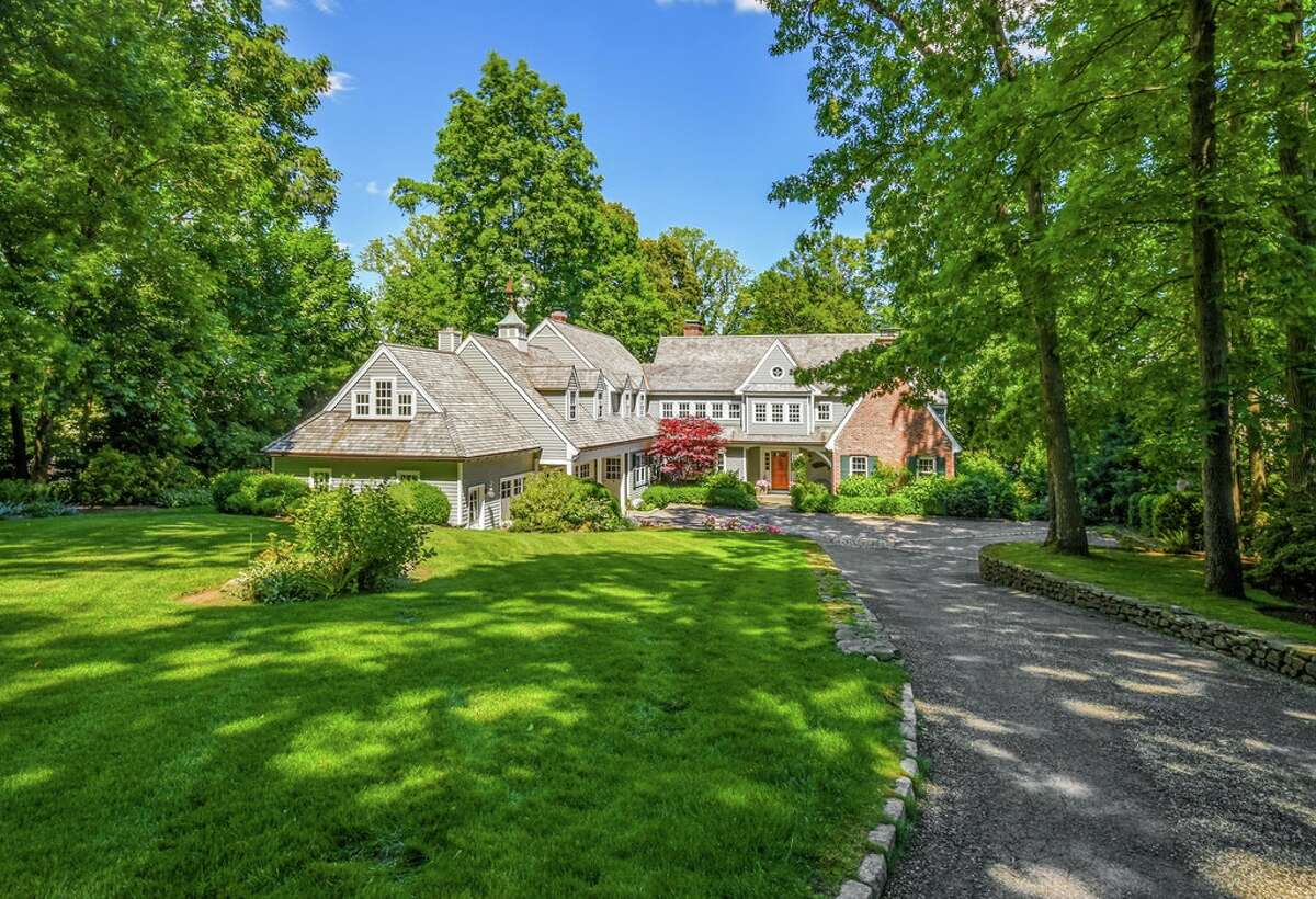 The home on 123 Long Neck Point Road in Darien, Conn. sits on 1.22 acres of land and has 118 feet of water frontage.