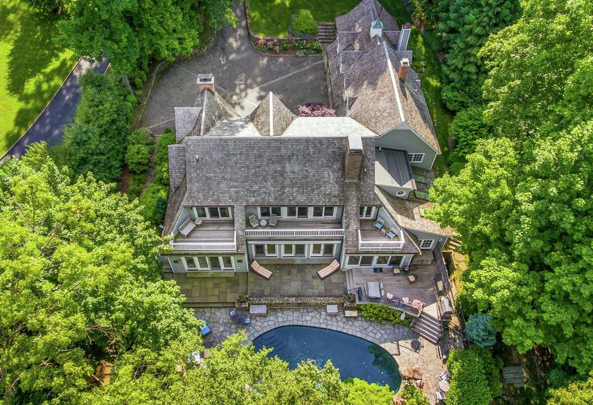 The home on 123 Long Neck Point Road in Darien, Conn. sits on 1.22 acres of land and has a heated in-ground pool with a waterfall, as well as views of Long Island Sound.