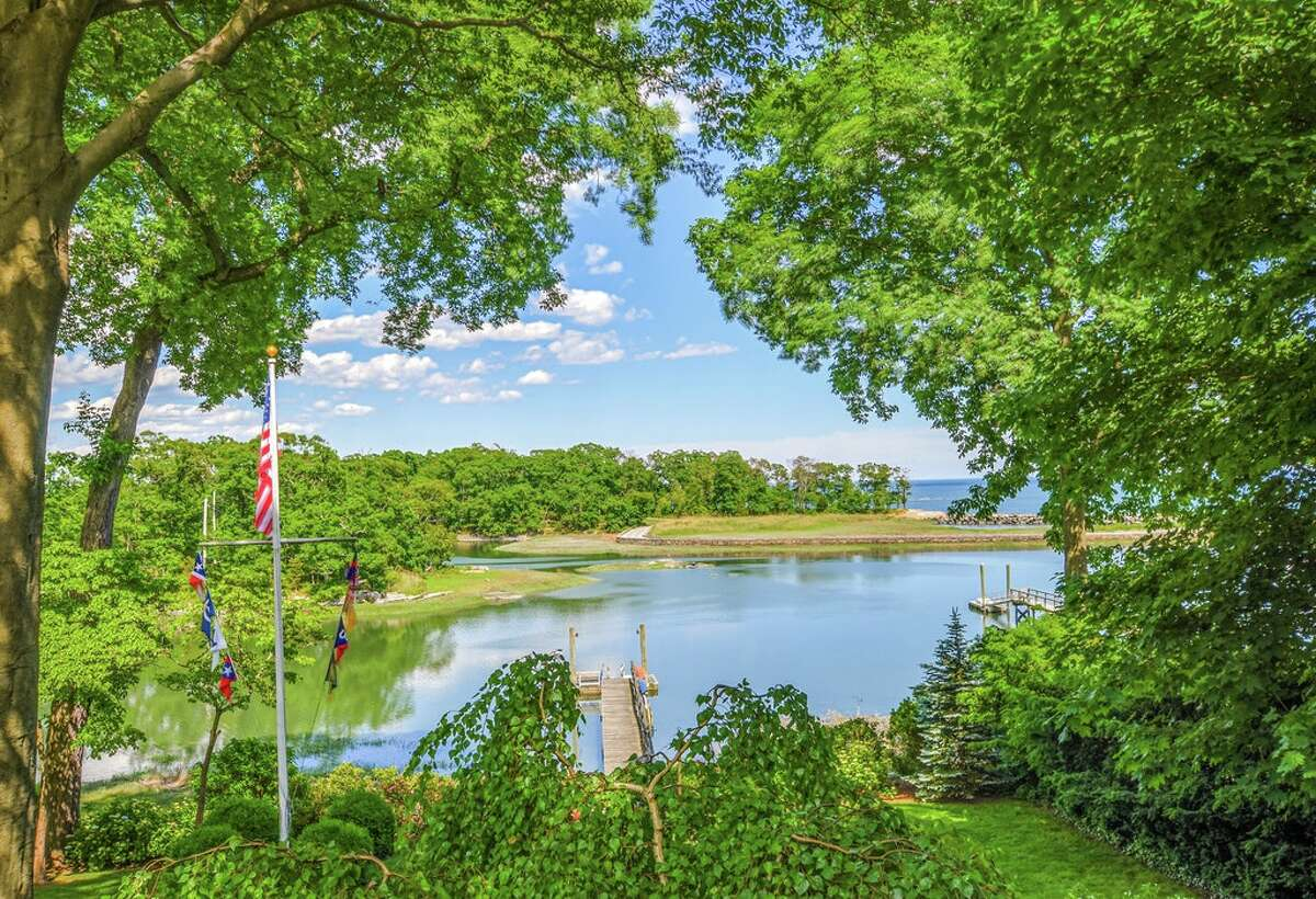 The home on 123 Long Neck Point Road in Darien, Conn. sits on 1.22 acres of land and has 118 feet of water frontage, as well as its own private tidal dock.