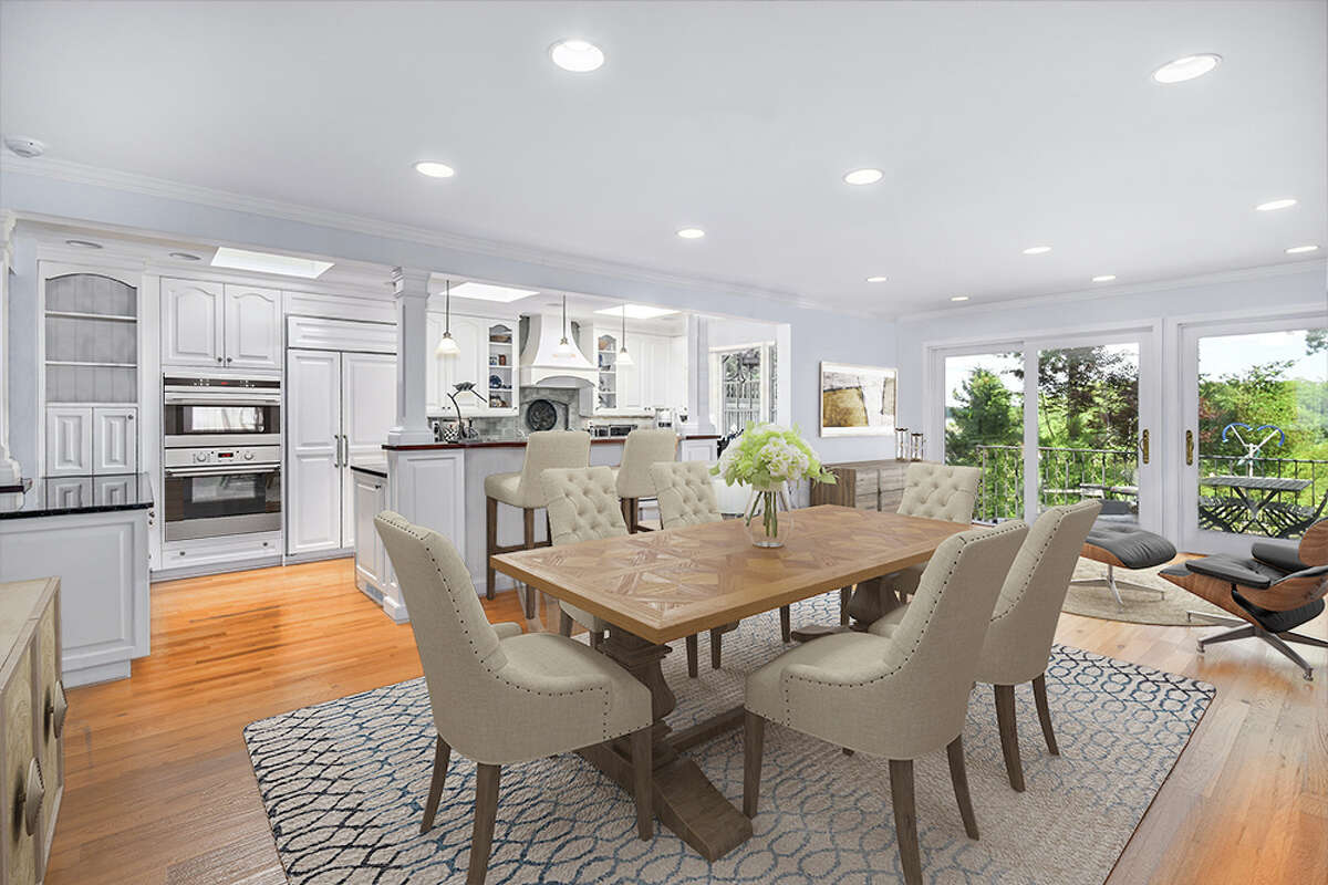 The main kitchen and dining space in the home on 123 Long Neck Point Road in Darien, Conn. has views of the protected harbor it overlooks.