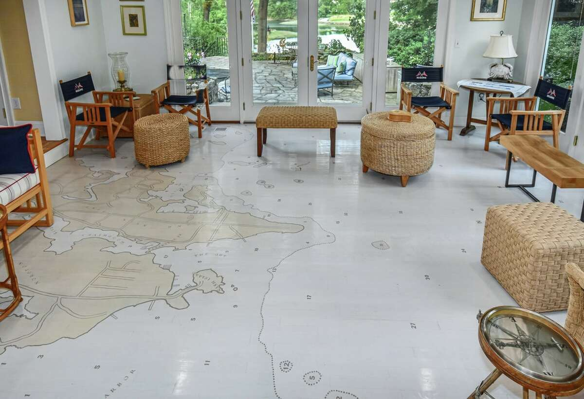 The home on 123 Long Neck Point Road in Darien, Conn. has a hand-painted map on the floor of the sunroom; it is one of a few murals painted throughout the home.