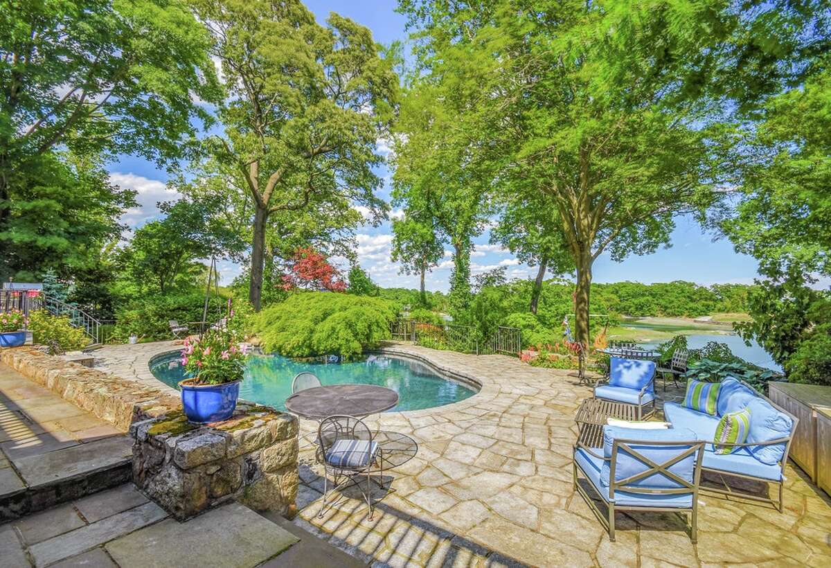 The home on 123 Long Neck Point Road in Darien, Conn. sits on 1.22 acres of land and a heated, in-ground pool.