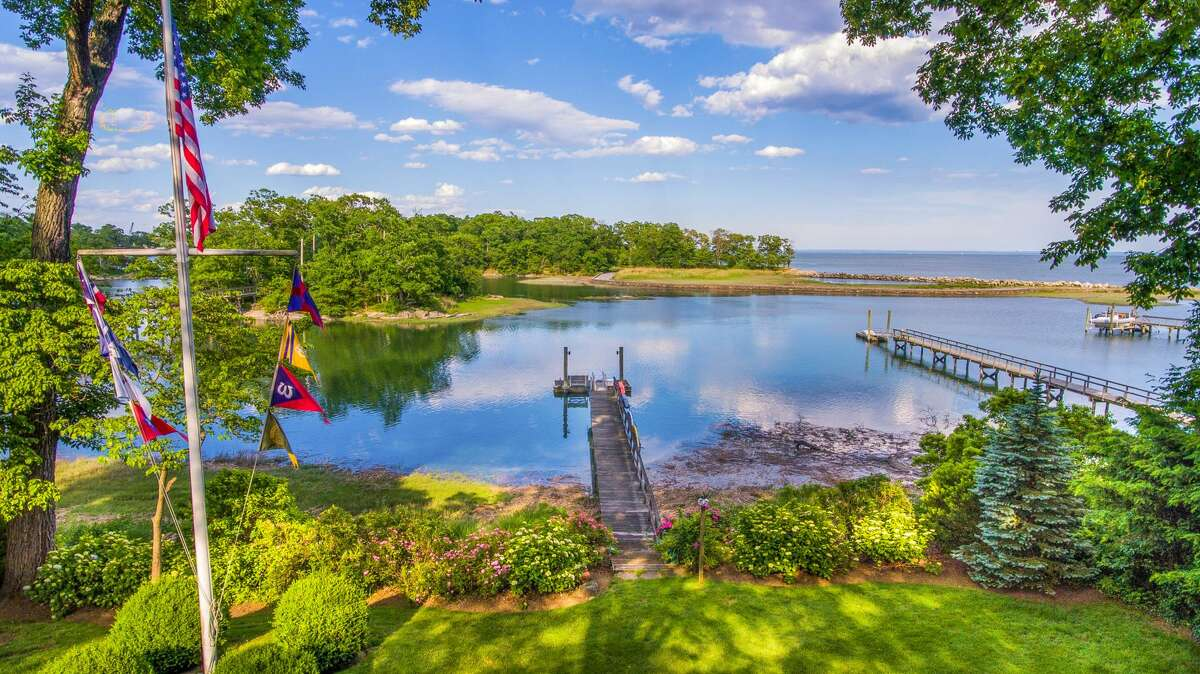 The home on 123 Long Neck Point Road in Darien, Conn. has 118 feet of water frontage, its own private tidal dock and views of a protected harbor and Long Island Sound.