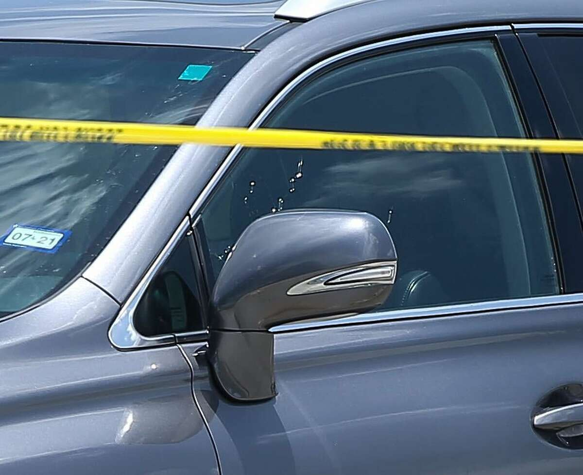 A vehicle sits at the scene of a shooting being investigated by police at the north entrance of North Forest High School, Wednesday, June 9, 2021, in Houston.