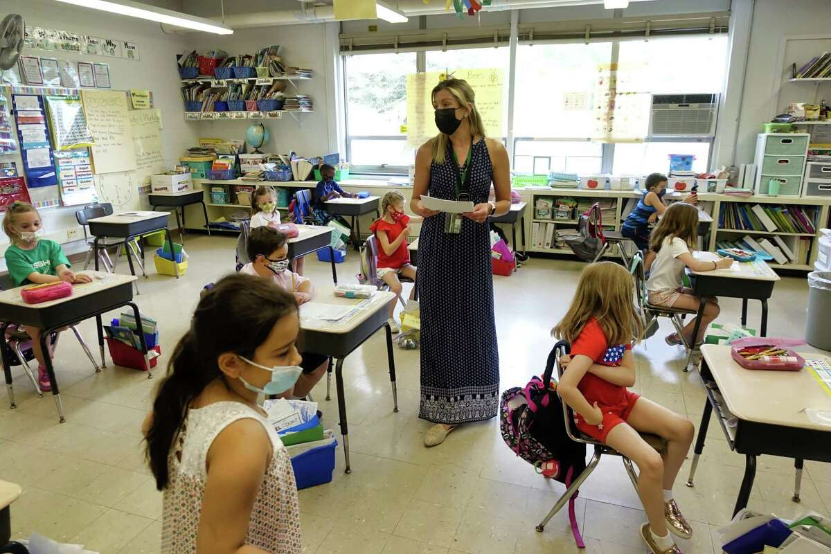 First Grade teacher Brooke Trotta works with her student at Karigon Elementary School on Tuesday, June 8, 2021, in Clifton Park, N.Y. (Paul Buckowski/Times Union)