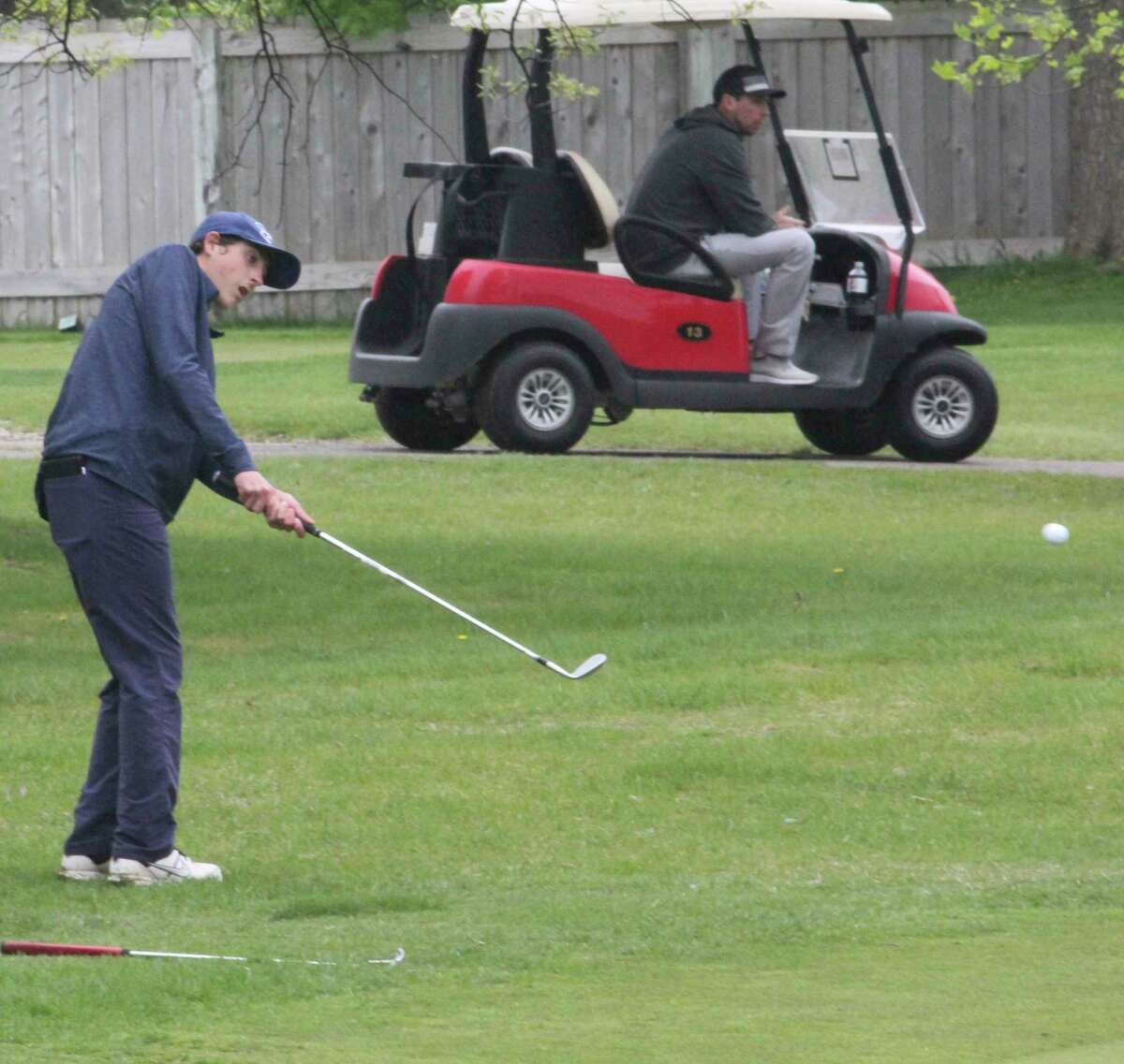 Brett Lilienthal, of Big Rapids, chips onto the green during a previous competition. (Pioneer file photo)