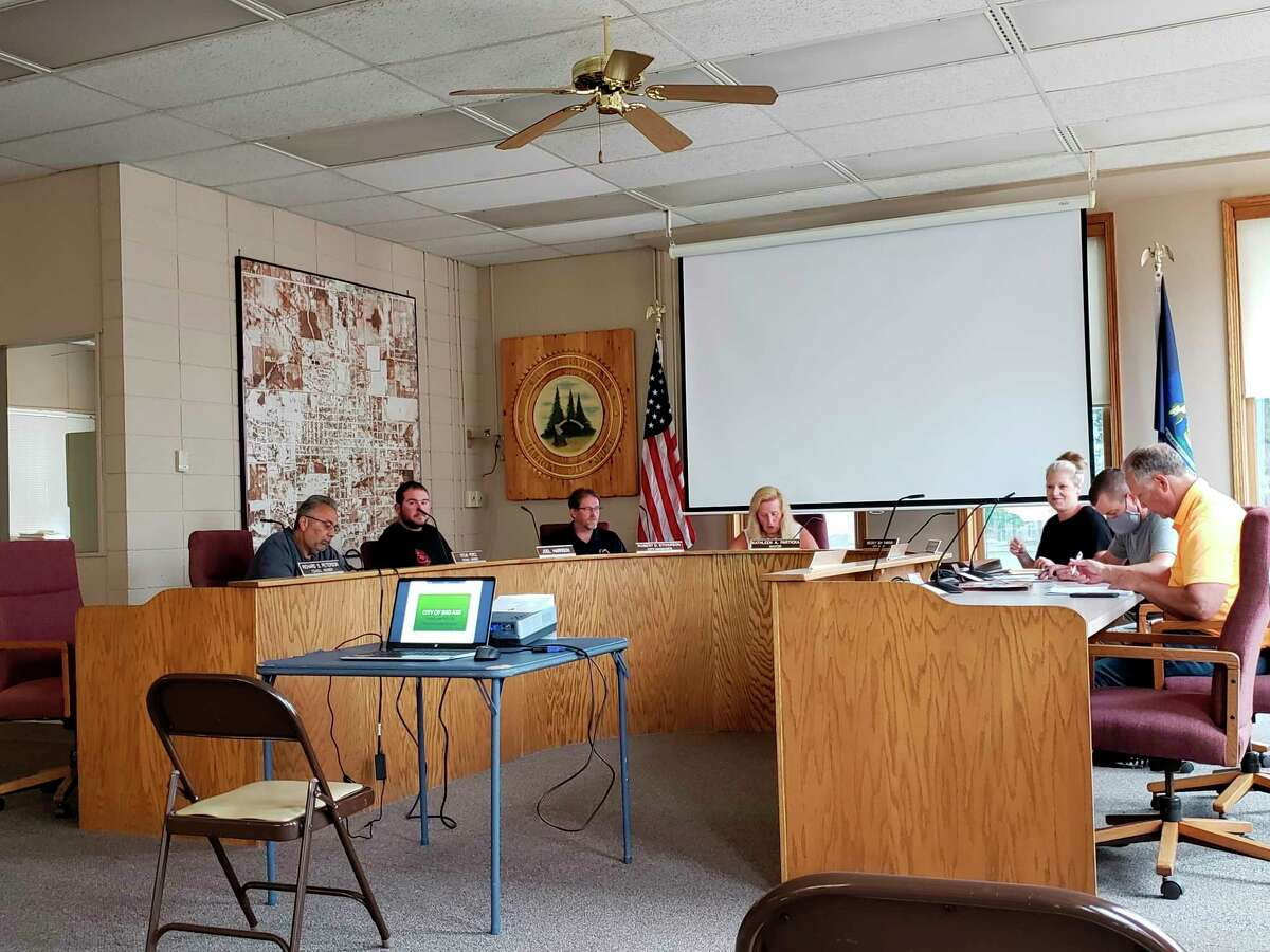 The Bad Axe City Council members chat before their meeting on Monday evening. The council received cost estimates for a proposed splash pad that were much higher than it anticipated. (Robert Creenan/Huron Daily Tribune)