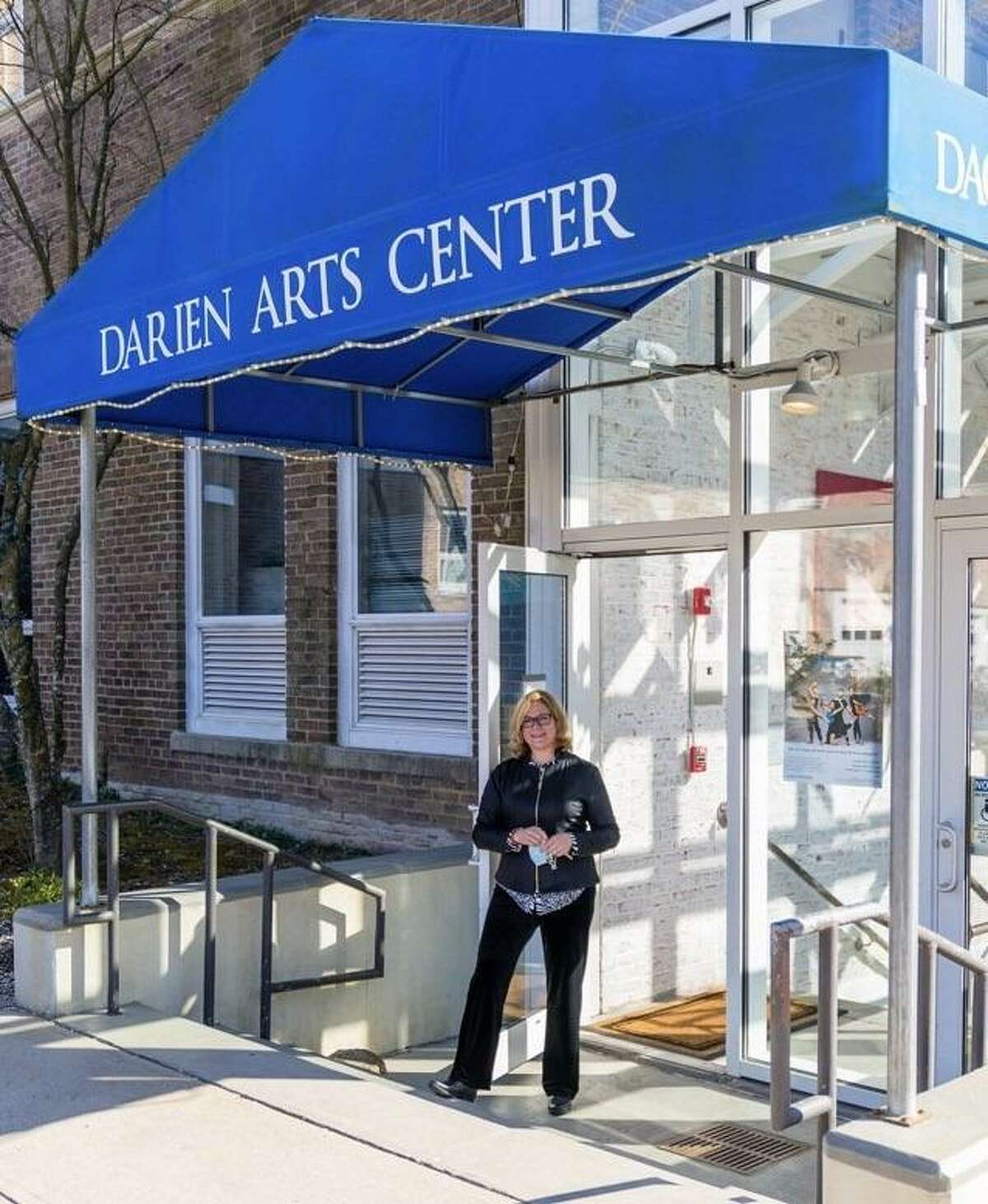 Amy Allen is the executive director of the Darien Arts Center in Darien. Allen is pictured here outside of the center's Weatherstone Studio.