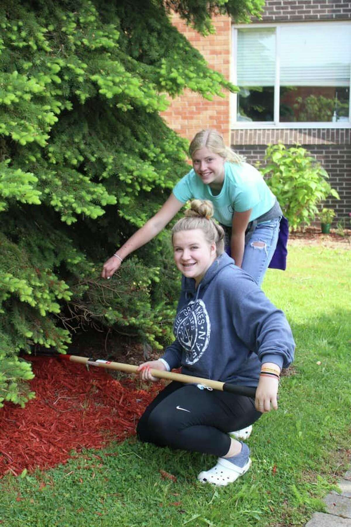 Harbor Beach FFA members help tend to gardens at the Harbor Beach Community Hospital. The organization's members help tend to the gardens and plant flowers there every year as one of many community service efforts. (Harbor Beach Community Schools/Courtesy Photo)