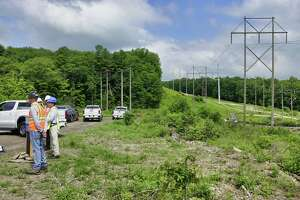 New York Power Authority President and Chief Executive Officer Gil Quiniones, second from left, speaks at a press event at the site where a new substation is being constructed on Wednesday, June 9, 2021, in Schenectady, N.Y. The work is part of the Central East Energy Connect transmission upgrade project.   (Paul Buckowski/Times Union)