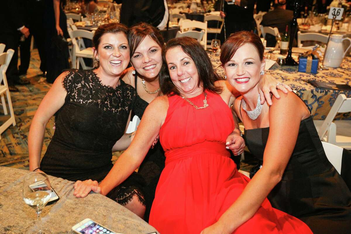 Attendees pose for the camera in this 2017 Houston Chronicle file image from the annual Celebration of Excellence Gala on Saturday, Oct. 7, 2017, at The Woodlands Waterway Marriott Hotel & Convention Center. This year's event is Saturday, Oct. 2, 2021, from 6-10 p.m.