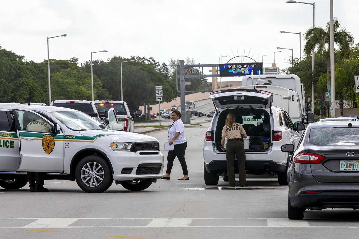 Police block an intersection near the Miami-Dade Kendall Campus in Miami, Fla., on Sunday, June 6, 2021. Three people are dead and at least six others injured following a shooting at a Florida graduation party, the latest in a string of such violence in the Miami area, police said Sunday. One of those killed was a state corrections officer, Miami-Dade police Director Freddie Ramirez told news outlets. (Daniel A Varela/Miami Herald via AP)