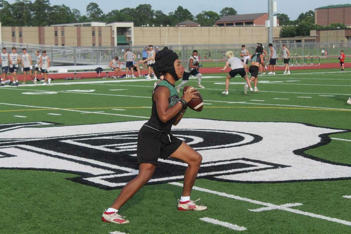 Kingwood Park freshman quarterback Jaxson Sims making throw during a 7on7 tournament at Panthers Stadium.