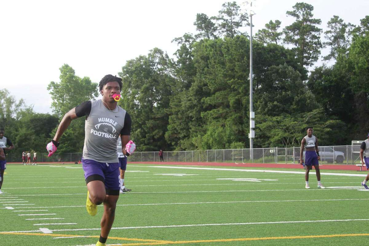 Humble wide receiver Trevonn McCray warming up before a 7on7 tournament at Panthers Stadium.