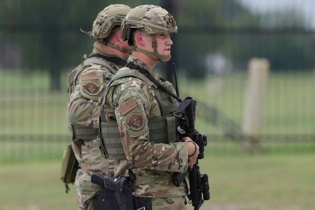 Soldiers guard the Gateway West Gate as Joint Base San Antonio-Lackland goes into full lockdown after an active shooter is reported, Wednesday, June 9, 2021.