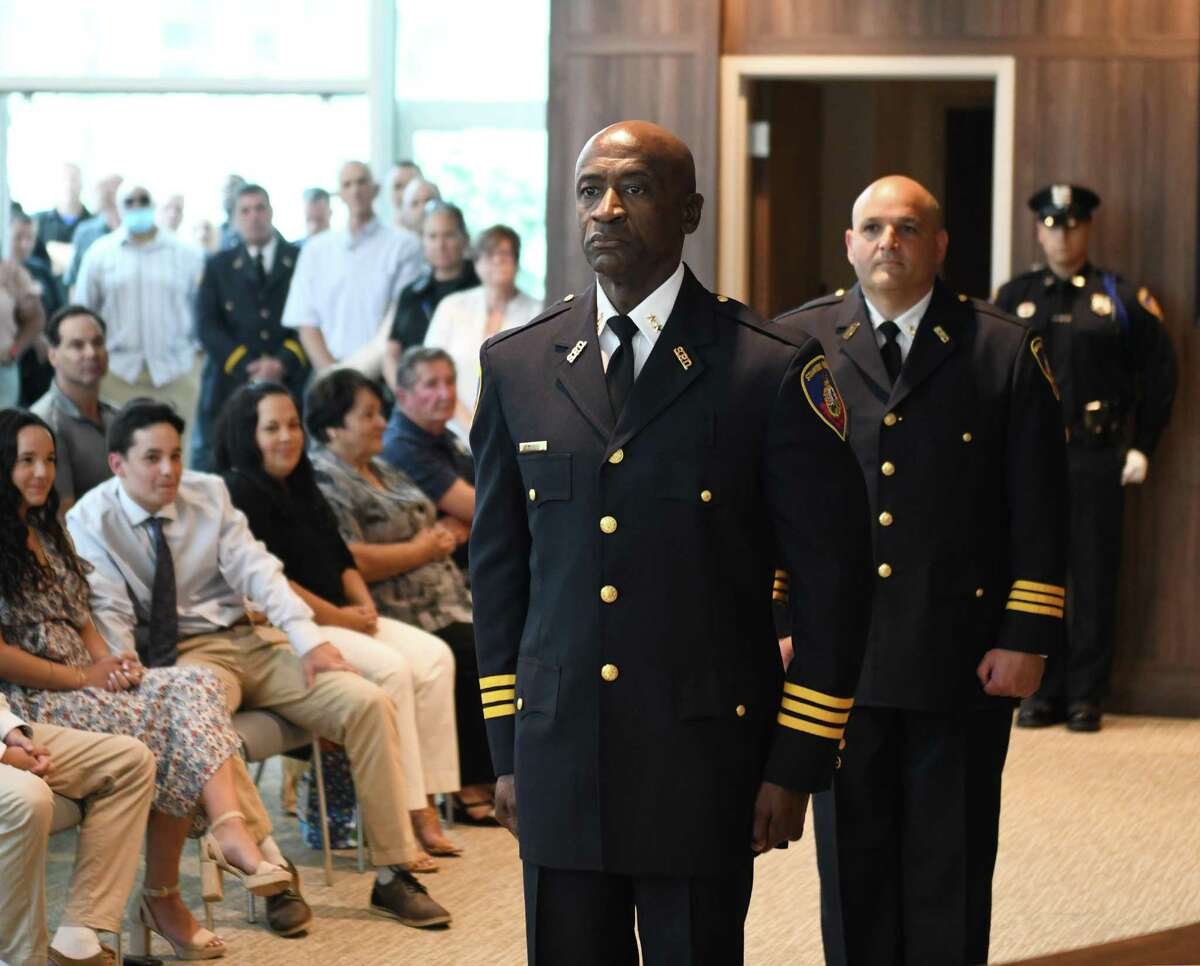 Officers Silas Redd, left, and Louis DeRubeis stand at attention during the ceremony promoting them to Assistant Police Chiefs at the Stamford Police Department in Stamford, Conn. Tuesday, June 8, 2021.