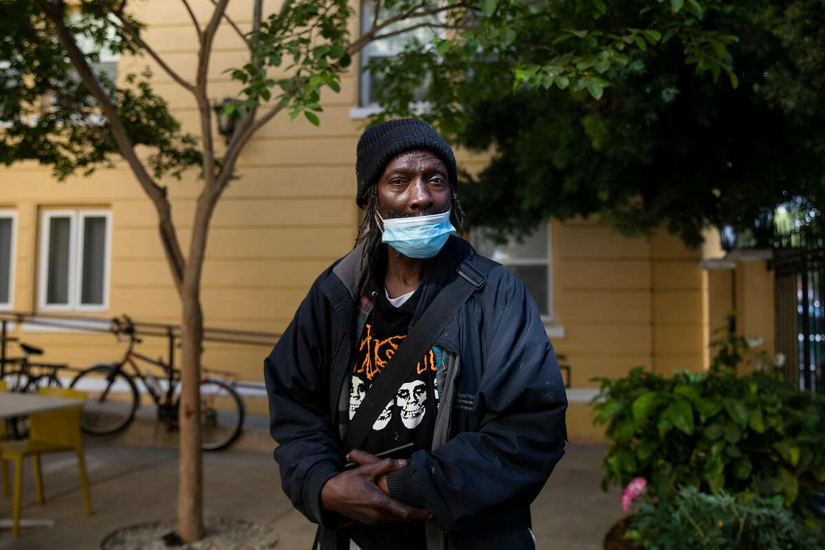 Anthony Bledsoe, a resident of Lake Merritt Lodge for the past two weeks, stands in the garden space before a press conference held outside of Oakland's Lake Merritt Lodge in Oakland, Calif. Wednesday, June 9, 2021. Oakland established Lake Merritt Lodge as a site for emergency COVID-19 response housing, intended to keep our most vulnerable homeless community members safe. The building is now at full occupancy.