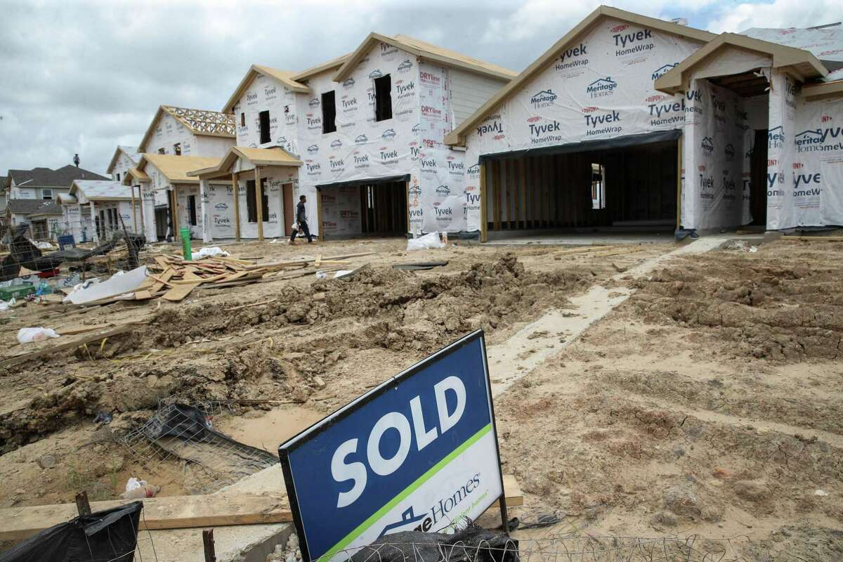 Nationally, home prices increased 17.2 percent in June 2021, compared to June 2020, according to CoreLogic. Home prices in Houston rose by 9.9 percent during the period. A sold sign sits in front of a home as construction continues in the Grand Trails subdivision in Richmond.
