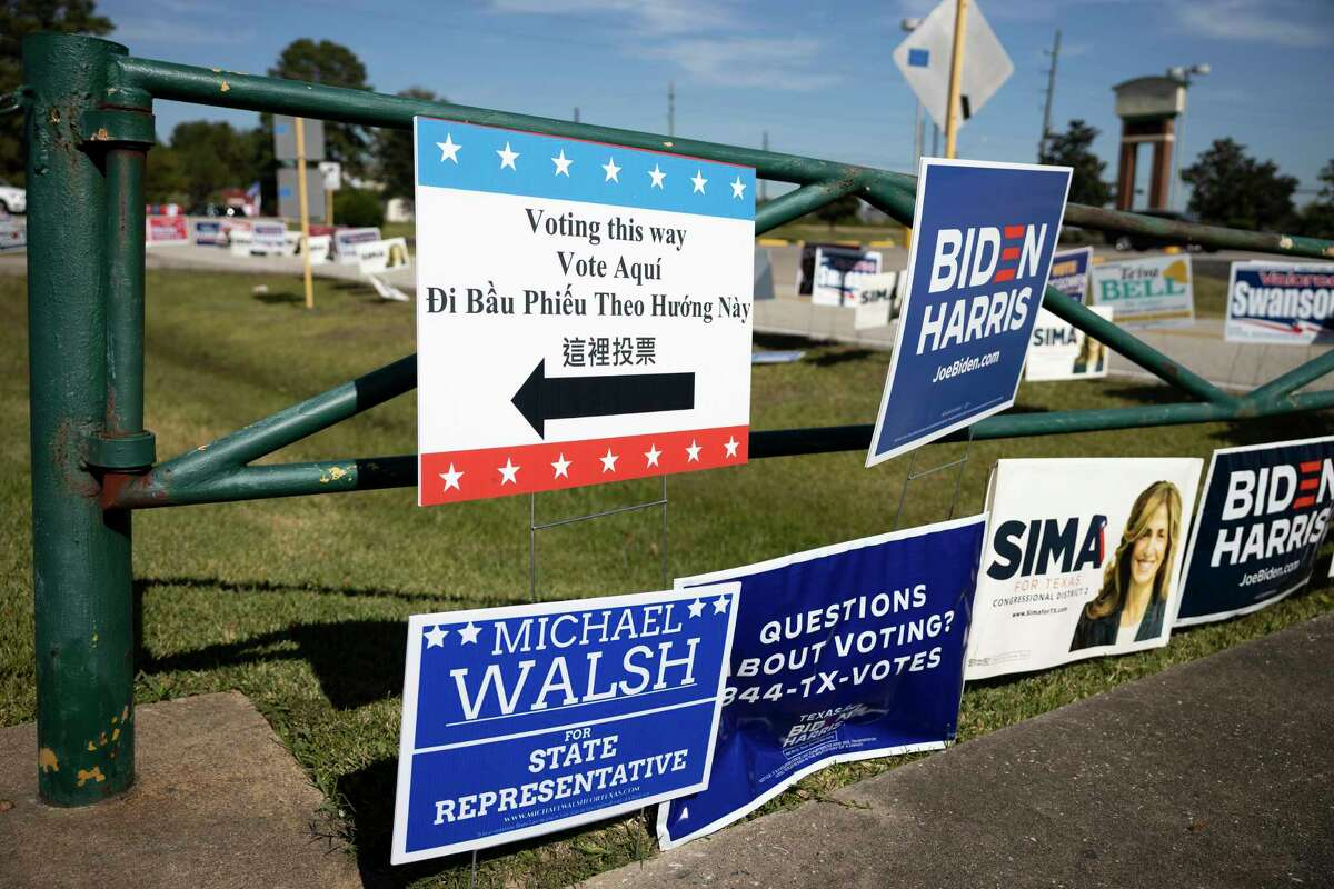 Political signs are placed near the Spring First Church on Election Day, Tuesday, Nov. 3, 2020, in Spring.