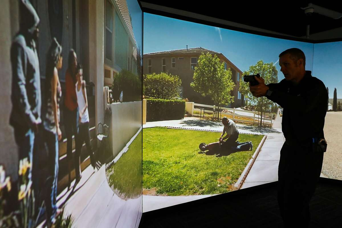 Legislation on how to decertify bad cops has divided lawmakers in Sacramento, even as police forces try to reform from within. Here, Sgt. Steven Pomatto of the San Francisco Police Department demonstrates use-of-force training in a simulator.