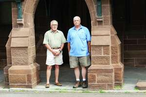 From left, Indian Hill Cemetery Association president/treasurer Jeffrey Burgess and cemetery Superintendent Norm Emond are shown outside the 1867 Gothic Revival chapel at 383 Washington St. in Middletown. It recently underwent $600,000 worth of renovations.