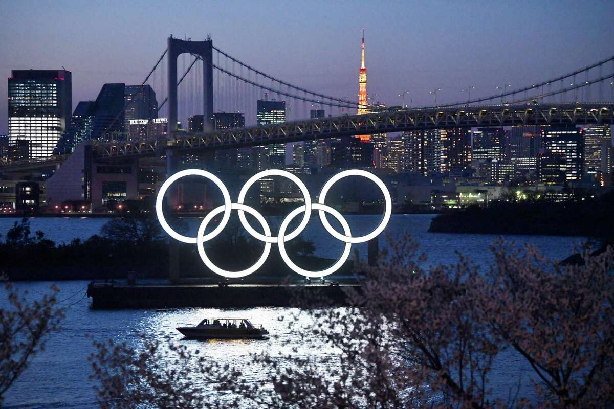 A boat sails past the Tokyo 2020 Olympic Rings on March 25, 2020, in Tokyo.