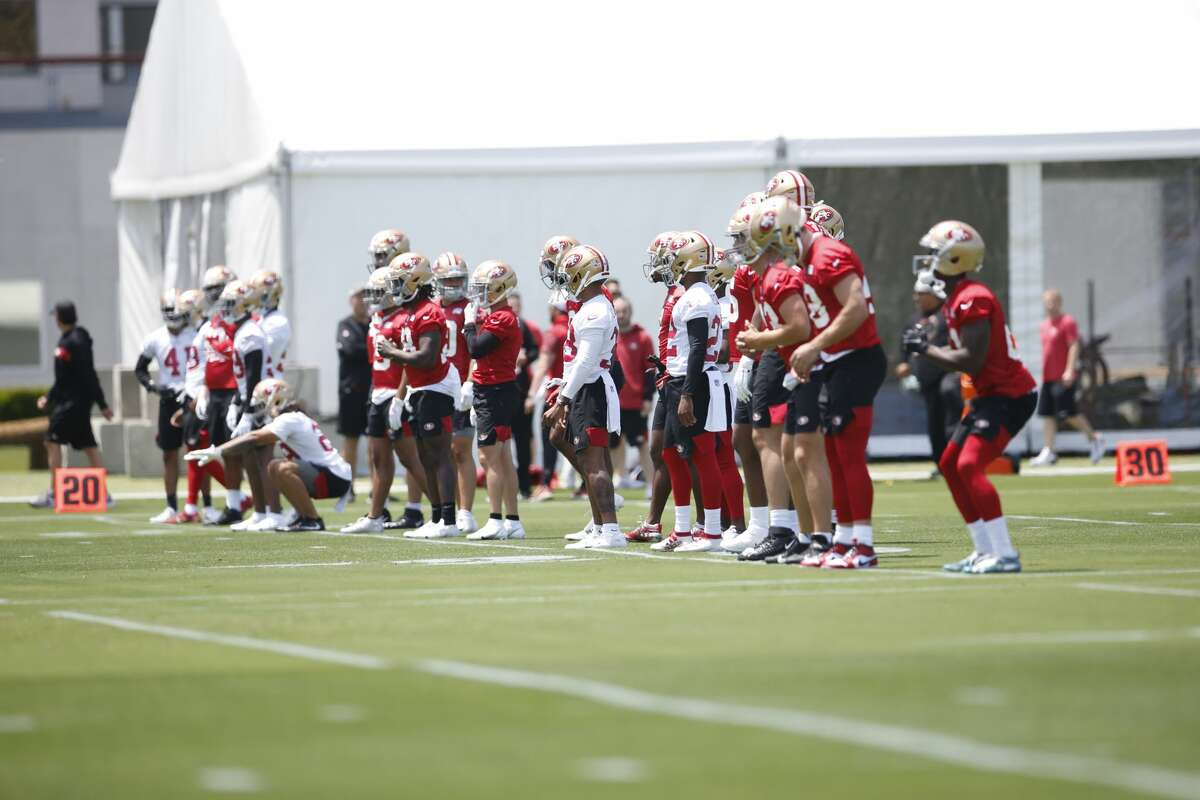 San Francisco 49ers players stretch during an OTA rookie mini camp at SAP Performance Facility on May 14, 2021, in Santa Clara, Calif.