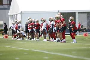 San Francisco 49ers players stretch during an OTA rookie mini camp at SAP Performance Facility on May 14, 2021 in Santa Clara, California.