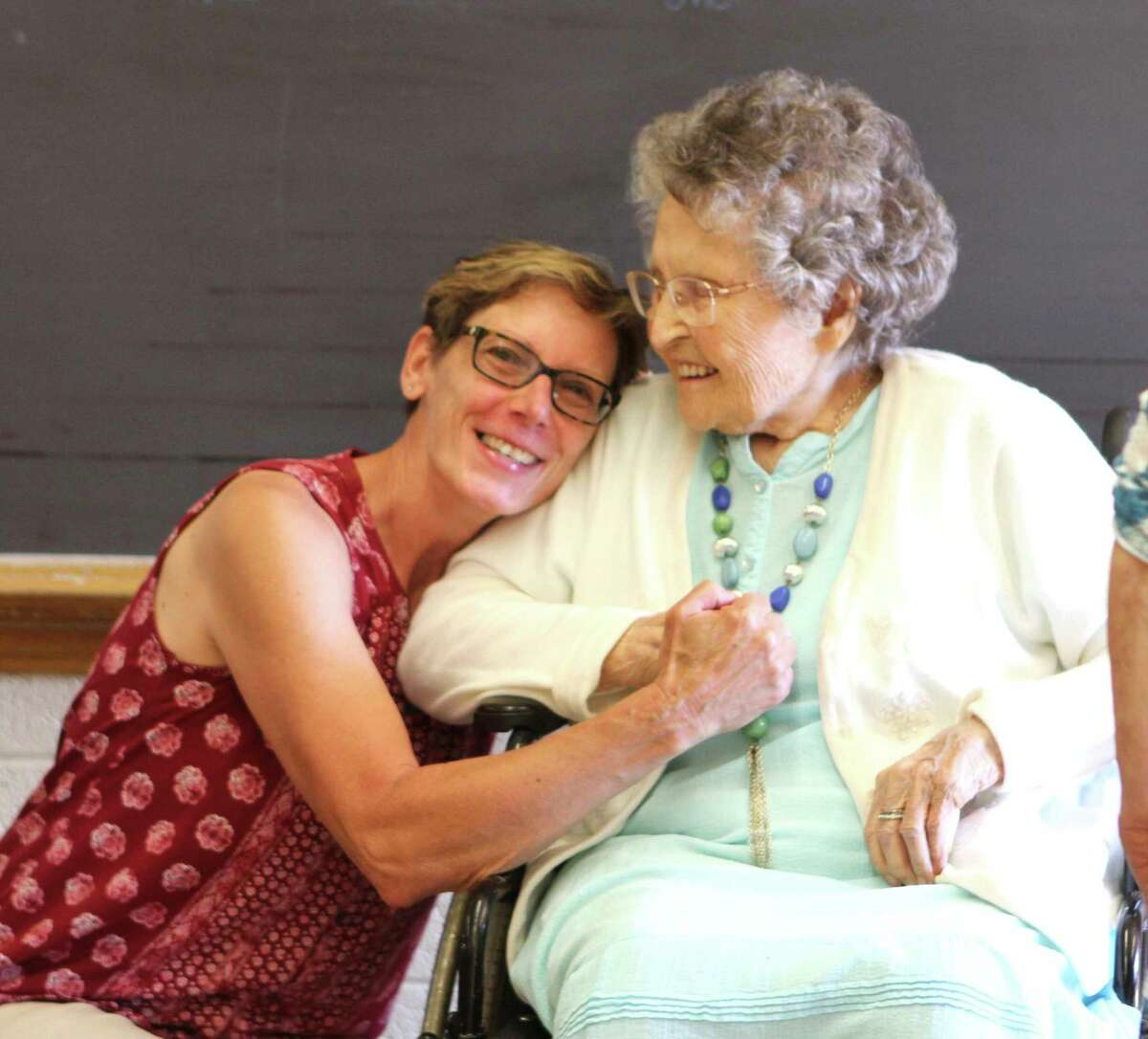At 101 years young, Doris Drake (right) receives a memorable hug from one of her former students. Drake was once a teacher at Barryton Elementary School and attended the final walkthrough of the building on June 5. (Pioneer photo/Gena Harris)