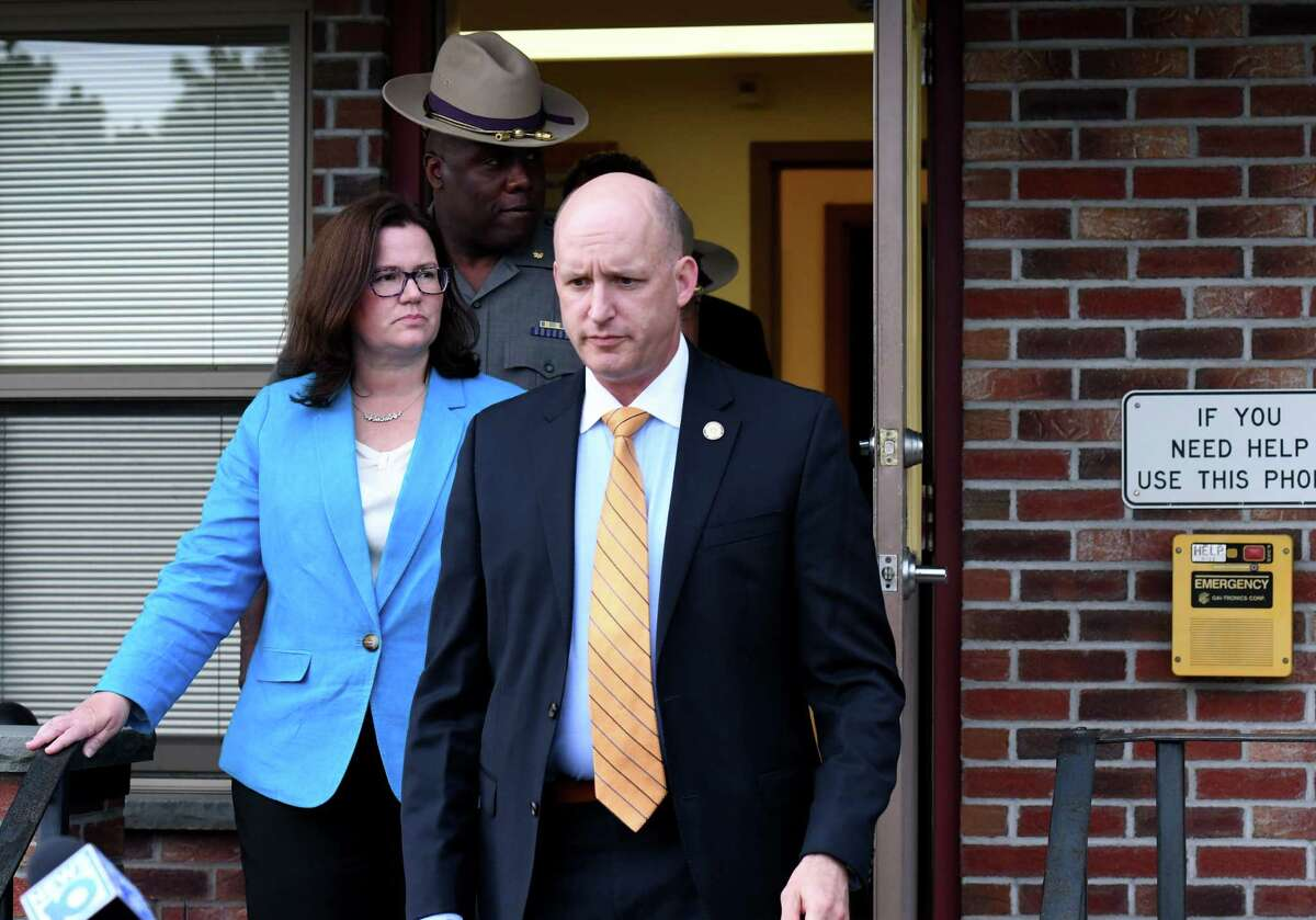 Capt. Robert Appleton, of State Police Troop G's Bureau of Criminal Investigation, right, is joined by Rensselaer County District Attorney Mary Pat Donnelly, left, and State Police officials during a briefing on the Jay Herrington Road homicide on Wednesday, June 9, 2021, at the Brunswick barracks in Brunswick, N.Y. (Will Waldron/Times Union)