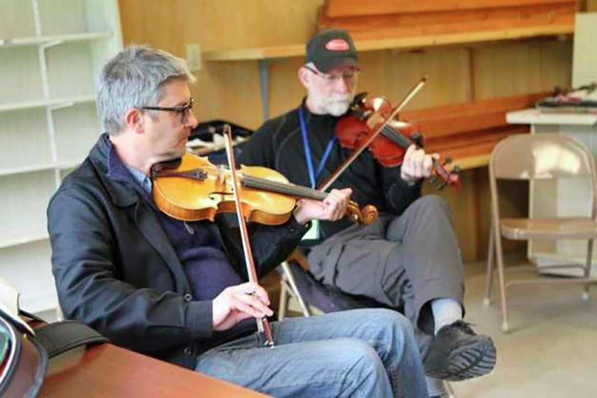 Patrick Ourceau (front) teaches an intermediate Irish fiddle class in June 2018 as part of Music and Dance Week at Wheatland. Ourceau, who was born in France, teaches lessons and tours around the world. (Pioneer file photo)