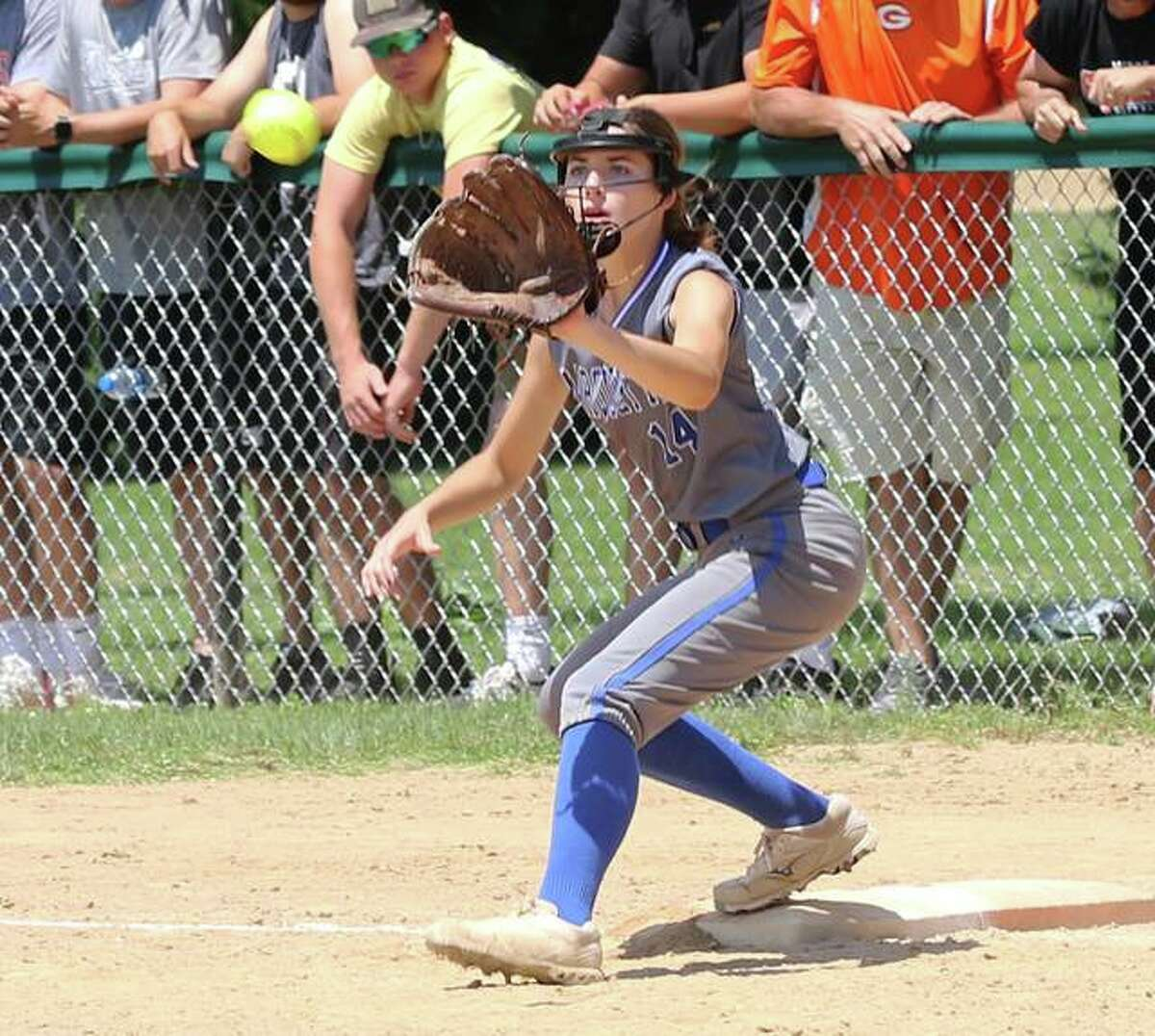 Marquette Catholic first baseman Carli Foersterling takes a throw for on out against Gillespie in a Class 2A regional title game last Saturday at Moore Park in Alton.
