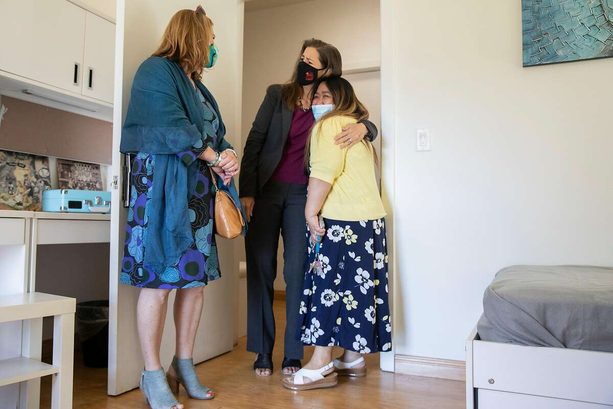 Oakland Mayor Libby Schaaf hugs Director of Homeless Progress Marichelle Alcantara while touring a unit inside Lake Merritt Lodge.