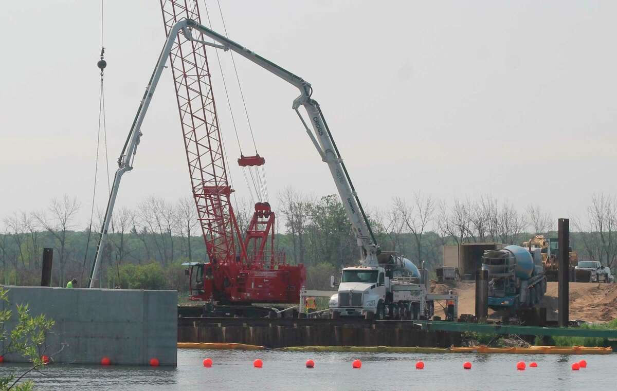 Work continues on the M-55 bridge on Wednesday in Manistee Township. Workers are expected to pour concrete for the abutment on the southeast end of the bridge next week. (Kyle Kotecki/News Advocate)